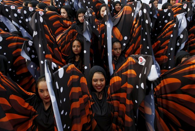 Girls dressed as butterflies perform during a meeting of Pope Francis (not pictured) and youths at the Jose Maria Morelos y Pavon stadium in Morelia, Mexico, February 16, 2016. (Photo by Carlos Garcia Rawlins/Reuters)