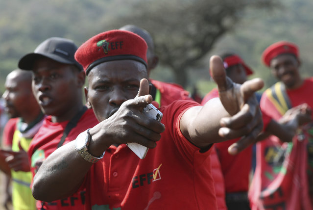 A protester gestures, as supporters of South Africa's leftist opposition party, the Economic Freedom Fighters, gather in Phoenix, South Africa, Thursday, August 5, 2021, during a demonstration against the killings of 36 people in Phoenix, a suburb of Durban, during the recent violent riots in KwaZulu-Natal province. More than 1,000 people marched through Phoenix to hand police a statement demanding justice for the families of those who were killed in that town during the violence. (Photo by AP Photo/Stringer)