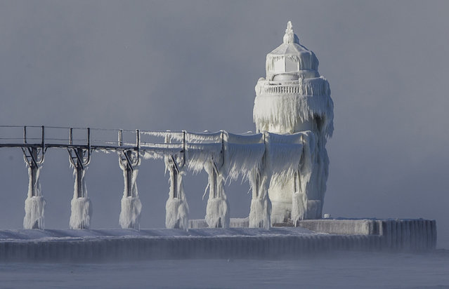 Extreme cold conditions cause ice accretions to cover the St. Joseph lighthouse and pier, on the southeastern shoreline of Lake Michigan, on Monday, December 19, 2016, in St. Joseph, Mich. (Photo by Robert Franklin/South Bend Tribune via AP Photo)