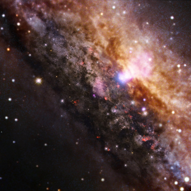 Galaxy NGC 4945 is similar in overall appearance to our own Milky Way, but contains a much more active supermassive black hole within the white area near the top. (Photo by Reuters/NASA)