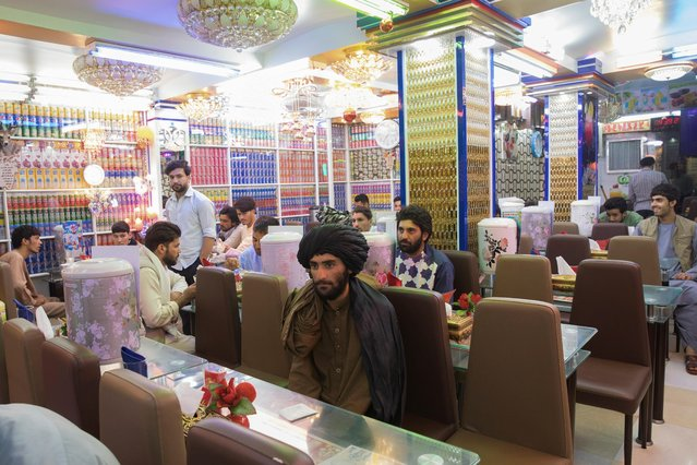 Afghan men are seen in a restaurant in Herat, Afghanistan on September 10, 2021. (Photo by WANA (West Asia News Agency) via Reuters)
