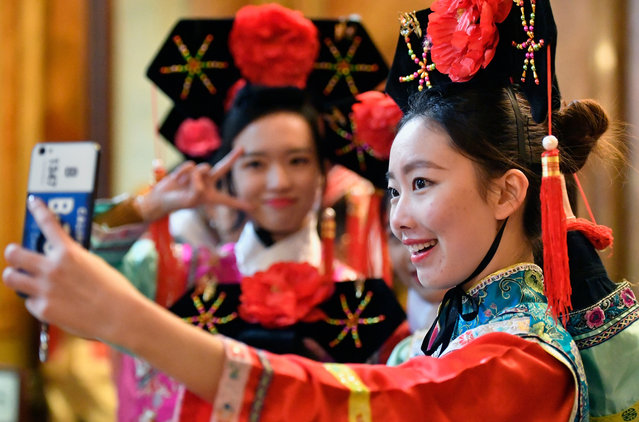 The Chinese community in Glasgow celebrate Chinese New Year in Glasgow City Chamber on January 29, 2017. (Photo by Jeff J. Mitchell/Getty Images)