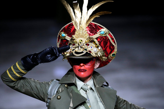 A model presents a creation by designer Hu Sheguang at China Fashion Week in Beijing, China, March 25, 2019. (Photo by Jason Lee/Reuters)