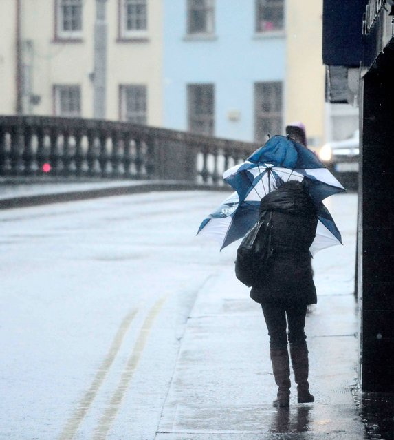 Battling the storm conditions in Cork City, on February 12, 2014. (Photo by Denis Scannell)