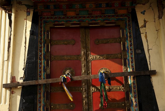 A door is barred to one of the damaged temples inside the ancient Swayambhunath Stupa complex after the April 25 earthquake in Kathmandu, Nepal, May 6, 2015. (Photo by Olivia Harris/Reuters)