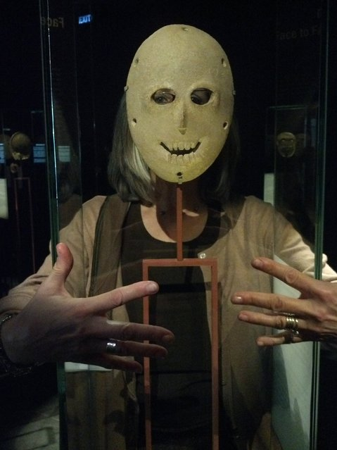 """The Israel Museum in Jerusalem posted on its Facebook page this visitor """"selfie"""" with one of the oldest masks in the world. (Photo by Israel Museum, Jerusalem/Facebook)"""