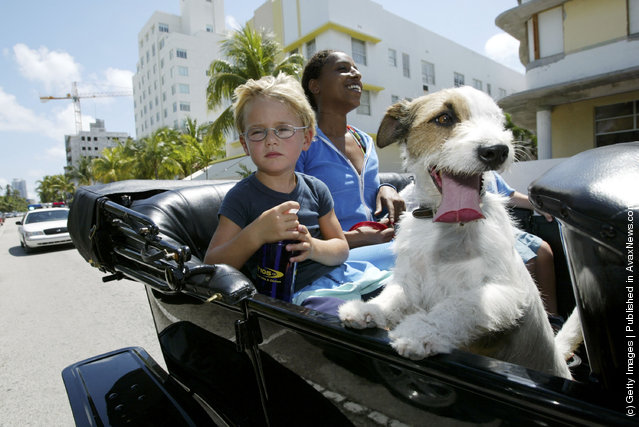 Leonardo Bode,4, from Miami, Florida and Naz Maizi from Miami, Florida take a spin in a Model T Ford