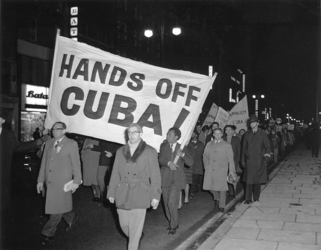Members of the Campaign for Nuclear Disarmament (CND) march during a protest against the U.S. action over the Cuban missile crisis, on October 28, 1962 in London, England. (Photo by Getty Images)