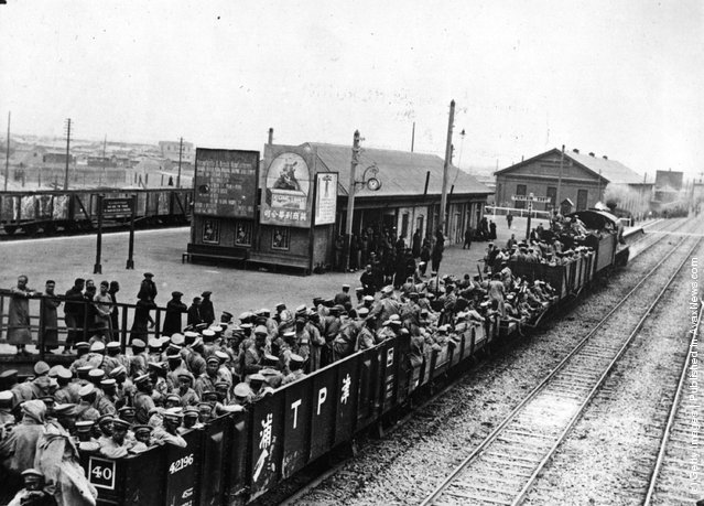 1922: This trainload of defeated Chang Tso-lin's Fengtien troops was photographed passing through a station in China during that country's Civil War
