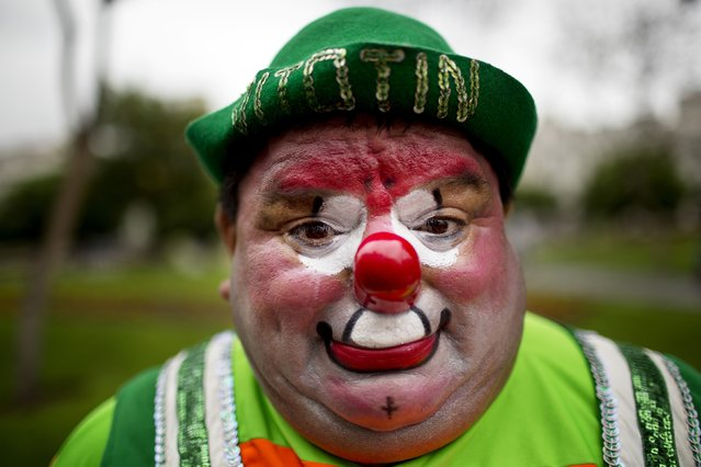 """Sorpresa"" the clown poses for a picture during a march commemorating Peruvian clown day in Lima Peru, Monday, May 25, 2015. (Photo by Rodrigo Abd/AP Photo)"