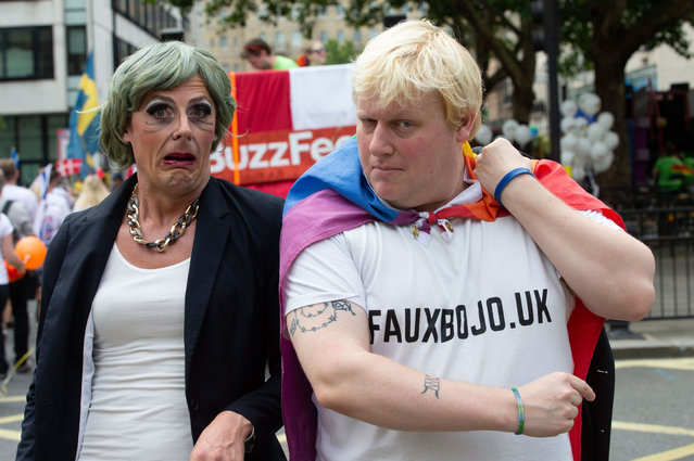 A fake Theresa May and Boris Johnson join Members of the Lesbian, Gay, Bisexual and Transgender community (LGBT) and their supporters, as they gather in central London, England for the annual Pride parade on July 6, 2019. (Photo by Mark Thomas/Rex Features/Shutterstock)