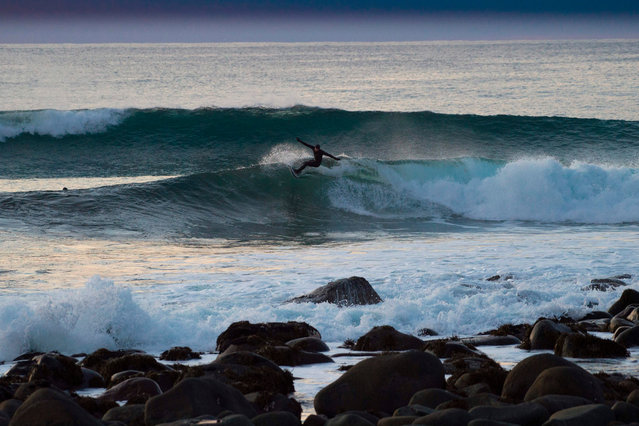 Norwegian surfer Espen Evertsen rides a wave at Unstad along the northern Atlantic Ocean on March 12, 2017, where the water temperatures is at five degrees centigrade and the air temperature is at minus two degrees centigrade. (Photo by Olivier Morin/AFP Photo)