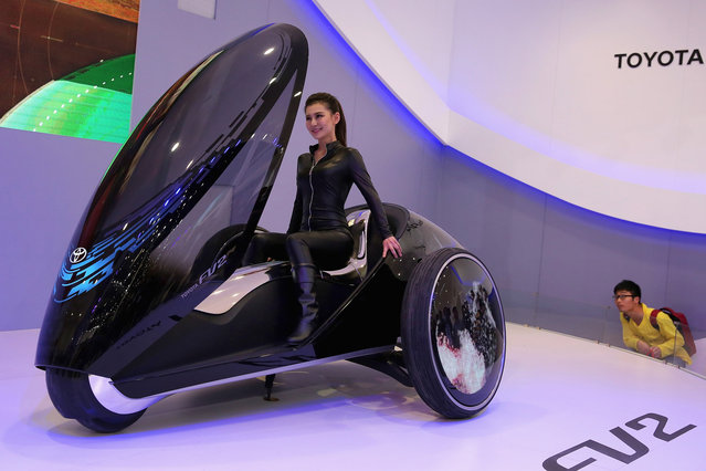 A model performs on the Toyota FV2 concept car during the 2014 Beijing International Automotive Exhibition at China International Exhibition Center on April 21, 2014 in Beijing, China. More than 2,000 automotive enterprises from 14 countries and regions participated in the 2014 Beijing International Automotive Exhibition from April 20 to April 29. (Photo by Feng Li/Getty Images)