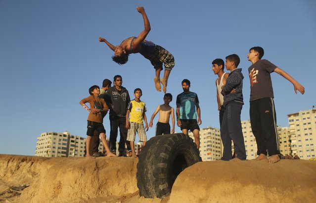 A Palestinian youth practices his parkour skills at Shati refugee camp in Gaza City April 27, 2014. (Photo by Mohammed Salem/Reuters)