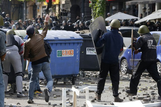 Pro-Russian activists hurl objects at supporters of the Kiev government in the streets of Odessa May 2, 2014. (Photo by Yevgeny Volokin/Reuters)