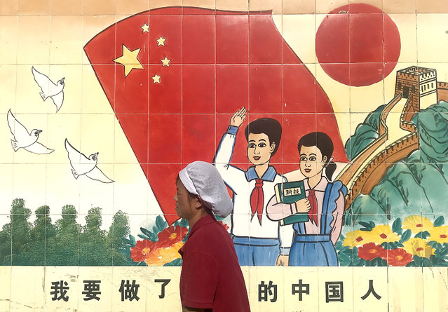 A mural extolling the virtues of the Communist party's education policy in Beijing, China on August 20, 2019. The party has ruled China for 70 years. (Photo by UPI/Barcroft Media)