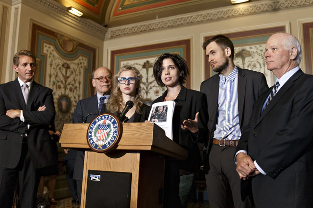 Russian political activists Nadya Tolokonnikova, center, and Maria Alyokhina, center left, of the Russian punk band p*ssy Riot, join Sen. Ben Cardin, D-Md., far right, the chairman of the Helsinki Commission, Sen. Jeff Flake, R-Ariz., far left, and Rep. Steve Cohen, D-Tenn., second from left, in seeking action to stop violations of human rights by pro-Russian militants in the Ukraine region, at the Capitol in Washington, Tuesday, May 6, 2014. (Photo by J. Scott Applewhite/AP Photo)