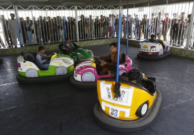 Afghan youths ride on bumper cars at City Park, during the first day of the Muslim holiday of Eid-al-Fitr, marking the end of the holy month of Ramadan, in Kabul, Afghanistan July 17, 2015. (Photo by Omar Sobhani/Reuters)