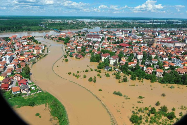 This image taken on taken Sunday, May 18, 2014 and made available by the Bosnia Army shows an aerial view of the flooded area near the Bosnian town of Brcko along the river Sava, 200 kms north of Bosnian capital of Sarajevo. Three months' worth of rain fell on the Balkan region in three days, producing the worst floods since rainfall measurements began 120 years ago. (Photo by AP Photo/Bosnia Army)