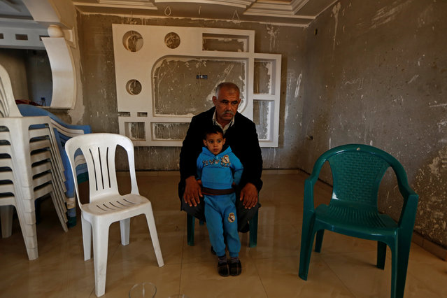 The father and son of Abdel Atti Abdelkabir, a policeman who was killed by Islamic State jihadists, pose for a picture in Ben Guerdane, Tunisia April 10, 2016. (Photo by Zohra Bensemra/Reuters)