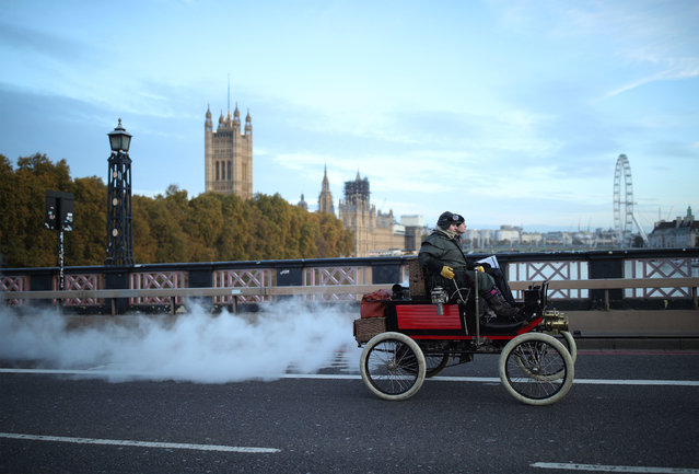 Participants driving their vehicle on Lambeth Bridge, London on November 3, 2019, during the Bonhams London to Brighton Veteran Car Run. (Photo by Yui Mok/PA Images via Getty Images)