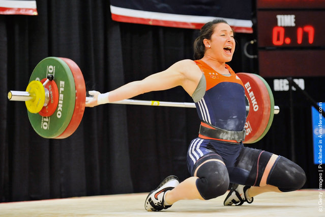 Natalie Burgener drops the bar behind her head while attempting to snatch 98 kilograms during the 2012 U.S. Olympic Team Trials for Women's Weightlifting