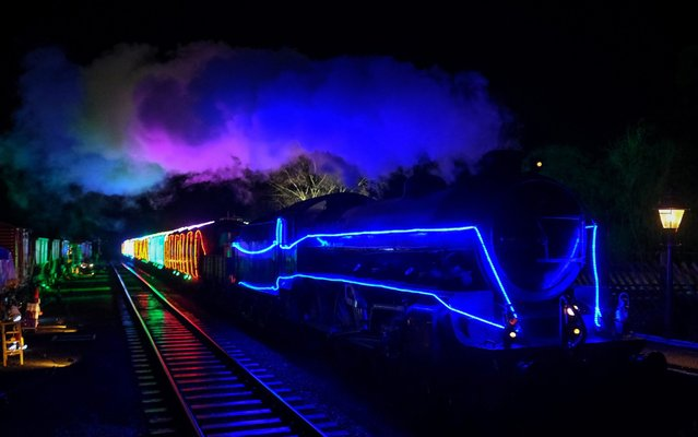 The North Yorkshire Moors Railway Northern Lights Express arrives at Levisham station during a media preview event on November 29, 2019 in Pickering, England. Travelling on the North Yorkshire Moors Railway heritage line the steam train, which is lit with a spectacular array of LED lights will carry passengers between Pickering and Levisham stations. The North Yorkshire Moors Railway is an award-winning charitable trust that carries 300,000 passengers every year. It is Britain's most popular heritage railway and is one of the most popular visitor attractions in Yorkshire. (Photo by Ian Forsyth/Getty Images)