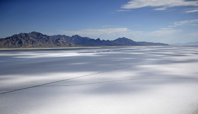 This Wednesday, July 22, 2015 photo shows an aerial view of the Bonneville Salt Flats in Utah. (Photo by Rick Bowmer/AP Photo)
