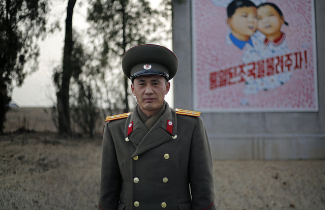 In this February 22, 2016, photo, North Korean People's Army Lt. Col. Nam Dong Ho poses for a portrait at the entrance to the Demilitarized Zone (DMZ) on the North Korean side. (Photo by Wong Maye-E/AP Photo)