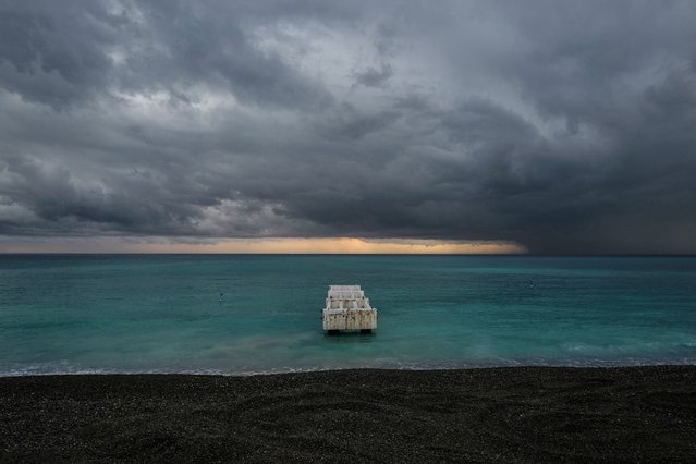 Clouds pass over the Mediterranean Sea during rain in the French Riviera city of Nice on November 7, 2019. (Photo by Valery Hache/AFP Photo)