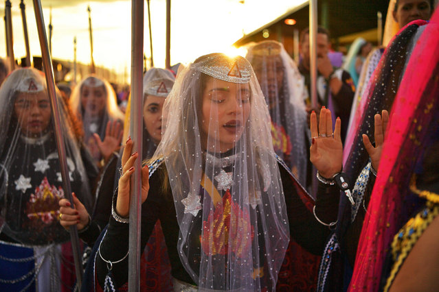 Nymphs, female devotees of the Vale do Amanhecer religious community, pray during their biggest ceremony of the year at their temple complex in Vale do Amanhecer (Sunrise Valley), a community on the outskirts of Planaltina, 50 km from the Brazilian capital, Brasilia, on May 1, 2019. This eclectic community holds its most important ritual of the year on Labour Day to honour the mediums who communicate with good and bad spirits. The group combines a range of religious practices, including Christian and Hindu, with symbols borrowed from the Incas and Mayans, as well as a belief in extraterrestrial life and intergalactic travel. With some 600 temples throughout Brazil, Portugal, Germany, Japan, Bolivia, Uruguay and the United States, the religious movement claims to have 800,000 members. (Photo by Carl De Souza/AFP Photo)