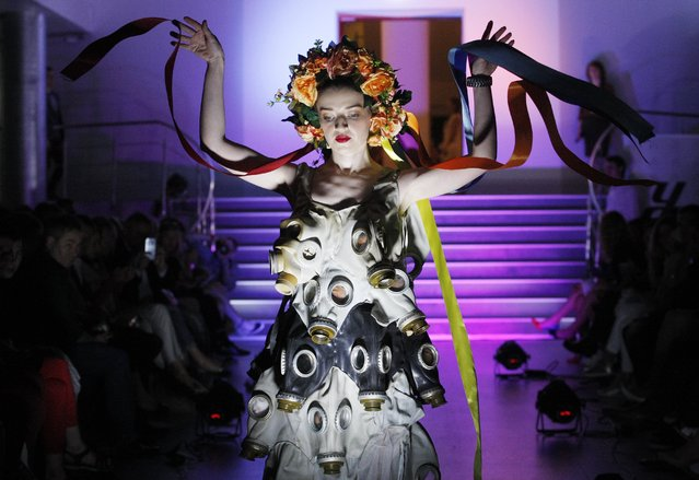 A model displays a creation by French designer Isagus Toche, during eco-clothing fashion show from recycled materials in Kiev, Ukraine, on 23 June 2017. (Photo by Stepan Franko/EPA/EFE)