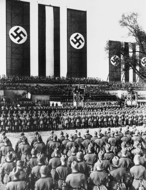 1st May 1934:  Massed ranks of German soldiers at the Tempelhof airfield to listen to a May Day speech by Hitler as Chancellor