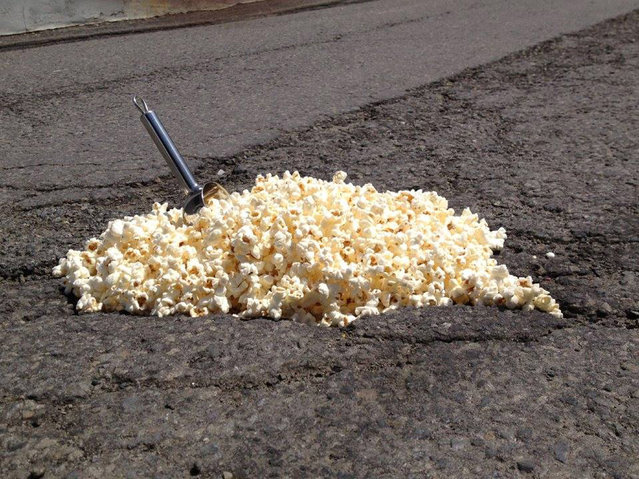 Funny pothole art: Popcorn machine pothole. (Photo by Caters News)