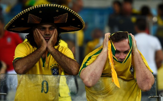 Emotional Brazil fans react after being defeated by Germany 7-1 during the 2014 FIFA World Cup Brazil Semi Final match between Brazil and Germany at Estadio Mineirao on July 8, 2014 in Belo Horizonte, Brazil. (Photo by Laurence Griffiths/Getty Images)