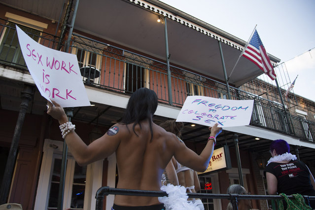A provocative sign is displayed during the Sexual Freedom Parade, part of Naughty in N'awlins held in New Orleans, Louisiana, Wednesday July 5th, 2017. (Photo by Mathew Growcoot/News Dog Media)