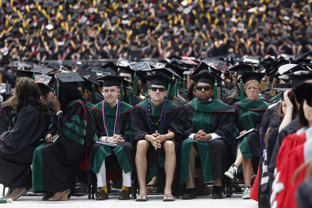 A student in flip flops and shorts receives an honorary degree during the spring commencement ceremony at Ohio State University in Columbus, May 5, 2013. (Photo by Jason Reed/Reuters)