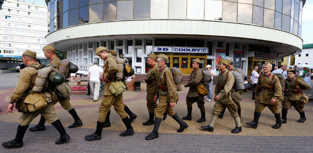 Military enthusiasts dressed as World War Two Red Army soldiers march as they mark the 75th anniversary of the Nazi Germany invasion, in Brest, Belarus June 21, 2016. (Photo by Vasily Fedosenko/Reuters)