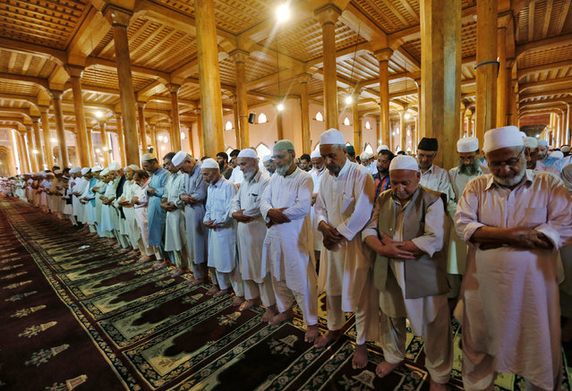 Muslims offer Friday prayers inside Jamia Masjid during the fasting month of Ramadan in Srinagar, India June 24, 2016. (Photo by Danish Ismail/Reuters)