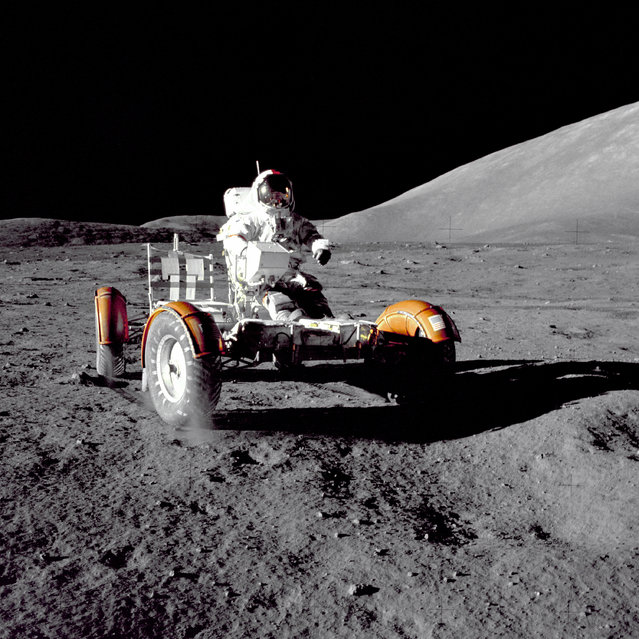"Astronaut Eugene A. Cernan, Apollo 17 mission commander, makes a short checkout of the Lunar Roving Vehicle during the early part of the first Apollo 17 extravehicular activity (EVA-1) at the Taurus-Littrow landing site. This view of the ""stripped down"" Rover is prior to loadup. This photograph was taken by Geologist-Astronaut Harrison H. Schmitt, Lunar Module pilot. The mountain in the right background is the East end of South Massif. (Photo by NASA)"