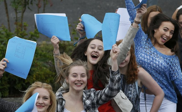 Georgina Morris (C) celebrates with other students after receiving her A-level results at Winstanley College in Wigan, Britain August 13, 2015. Georgina gained 2A* and 2A grades in her A-Level exams. (Photo by Andrew Yates/Reuters)