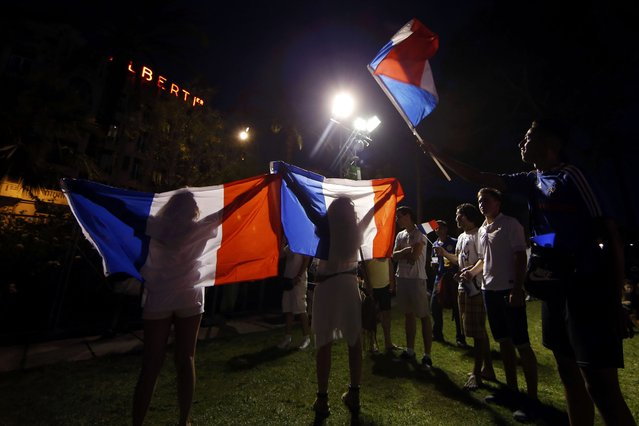 France fans react in the fan zone during the France v Iceland EURO 2016 quarter final soccer match in the fan zone in Nice, France, July 3, 2016. (Photo by Eric Gaillard/Reuters)