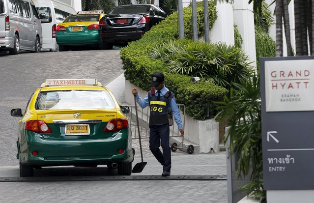 A security checks on a taxi entering a hotel building after Monday's deadly blast, in central Bangkok, Thailand, August 20, 2015. International terrorists were not suspected of the bomb attack in Bangkok this week that killed 20 people and China was not the target, Thai authorities said on Thursday, as police said they believed at least 10 plotters were involved. (Photo by Kerek Wongsa/Reuters)