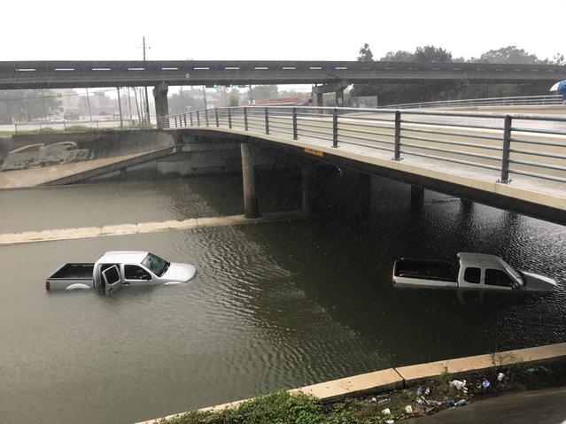 Vehicles sits half submerged in flood waters under a bridge in Houston, Texas on August 28, 2017. (Photo by Ernest Scheyder/Reuters)