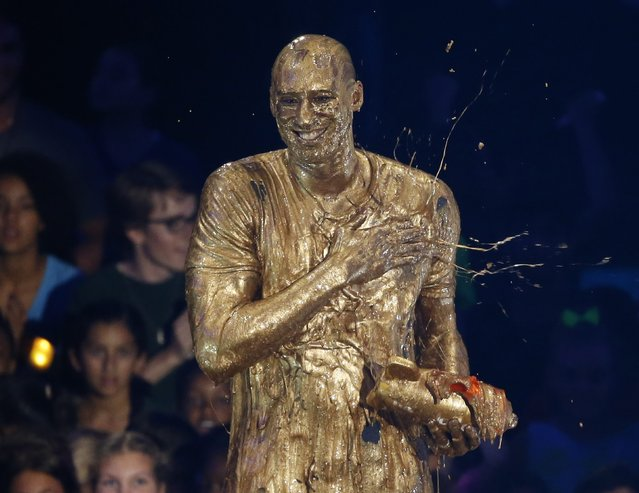 "Retired NBA basketball player Kobe Bryant reacts after he was ""slimed"" after accepting the ""Legend"" award at the Kids Choice Sport 2016 awards in Los Angeles, California U.S., July 14, 2016. (Photo by Mario Anzuoni/Reuters)"