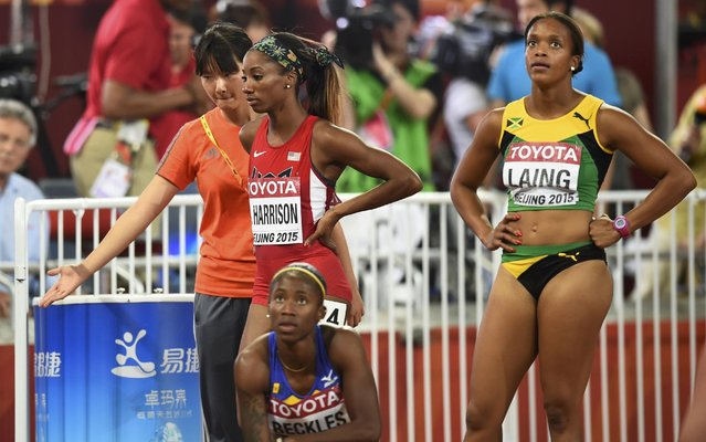 Kendra Harrison of U.S. (C) looks dejected after she was disqualified for a false start in the women's 100 metres hurdles semi-final during the 15th IAAF World Championships at the National Stadium in Beijing, China August 28, 2015. (Photo by Dylan Martinez/Reuters)
