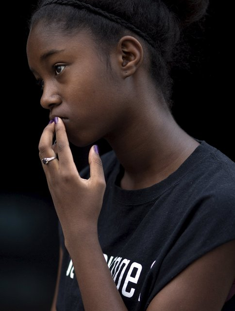 """Participant Isis Watson listens during a moment of prayer during the African American Leadership Project's """"Hands Around the Superdome"""" march and ceremony  in New Orleans, Louisiana August 29, 2015. (Photo by Edmund D. Fountain/Reuters)"""