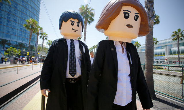 A husband and wife dressed as life-size Lego versions of agents Mulder and Scully from the X-Files during opening day of the annual Comic-Con International in San Diego, California, United States July 21, 2016. (Photo by San Diego Union/Rex Features/Shutterstock)