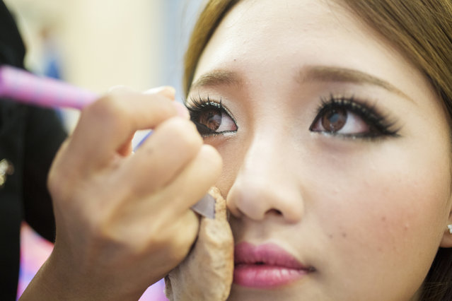 Catherine Hui, a contestant in the Miss NY Chinese Beauty Pageant 2014, has makeup applied before the show at the Mohegan Sun casino in Uncasville, Conn. In its 13th year, MNYCBP has become one of the most influential Chinese events in the U.S., while providing a major platform for American Chinese girls to enter the entertainment industry in China. (Photo and caption by John Brecher/Sahra Vang Nguyen/NBC News)