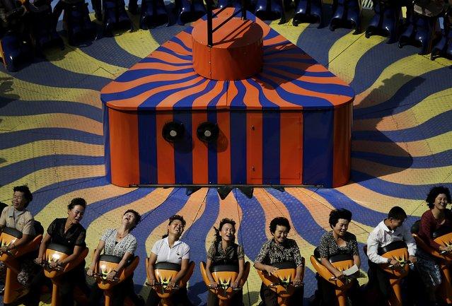 North Koreans enjoy a ride at the Kaeson Youth Amusement Park Wednesday, September 3, 2014 in Pyongyang, North Korea. (Photo by Wong Maye-E/AP Photo)